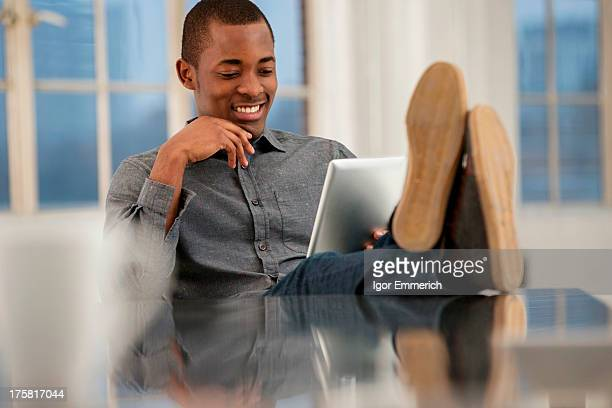 Male office worker sitting at desk with feet up