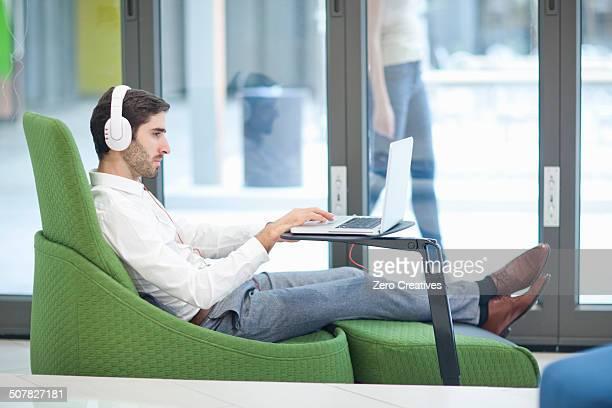Male office worker using laptop