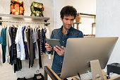 Man manager of Fashion Store with digital tablet and computer pc