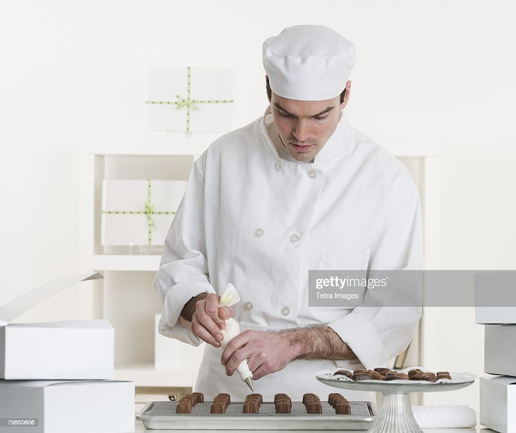 Male pastry chef in kitchen : Stock Photo