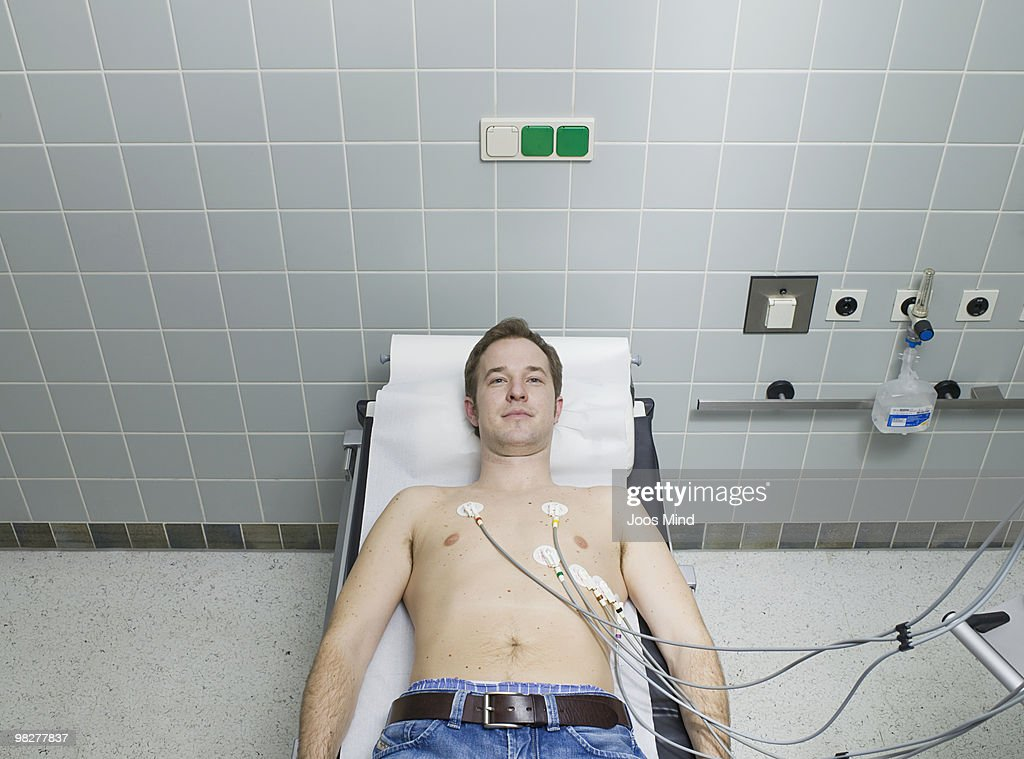male patient receiving electrocardiogram : Stock Photo