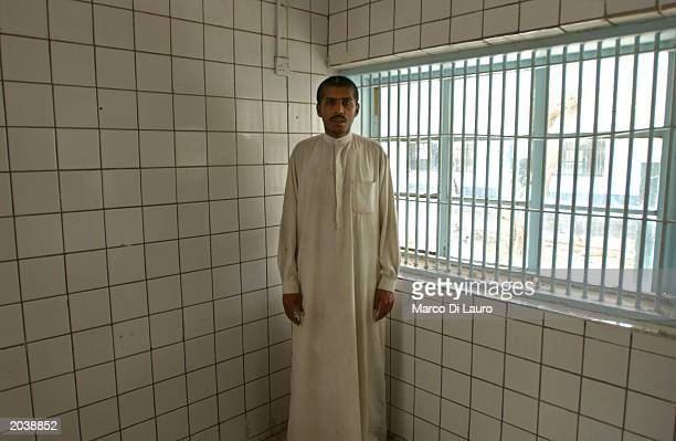 A male patient stands in a room at the Al Rashad psychiatric hospital May 29 in Baghdad Iraq The hospital has been in complete disarray since being...