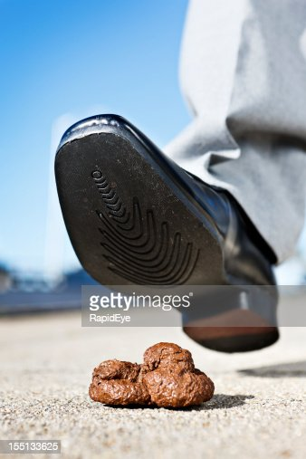 Male pedestrian's smart shoe about to tread in dog feces