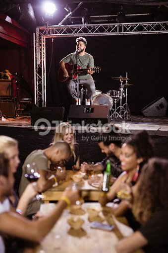 Male Performer Singing On Stage Stock Photo | Thinkstock