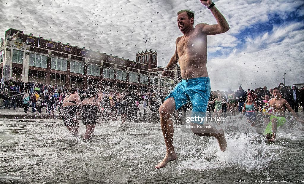 CONTENT] A male person jumps into the frigid Atlantic Ocean during the Sons of Ireland Polar Bear Plunge, New Year's Day 2014, Asbury Park, New Jersey