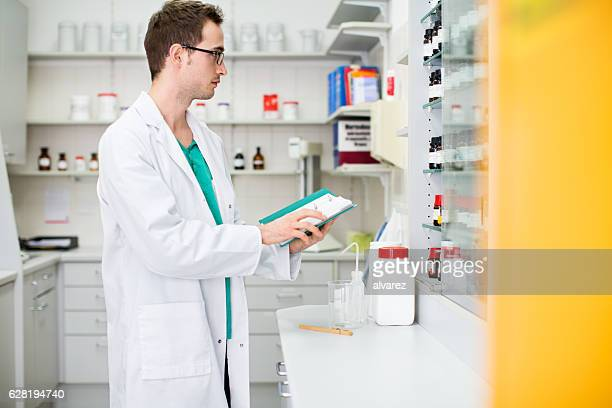 Male pharmacist working at the chemist store