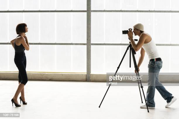 Male Photographer with Female Model During Shoot