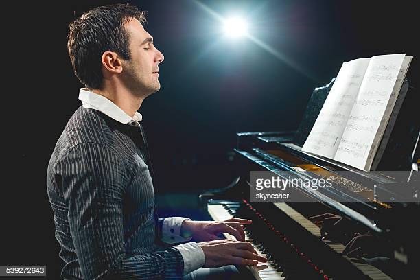 Male pianist.