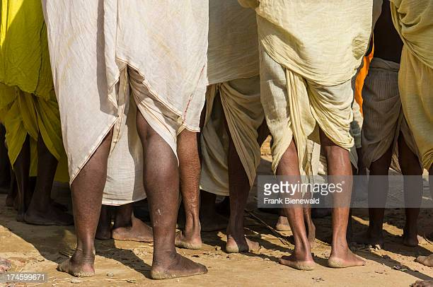 Male pilgrims wearing the traditional dhoti at the Sangam the confluence of the rivers Ganges Yamuna and Saraswati at Kumbha Mela