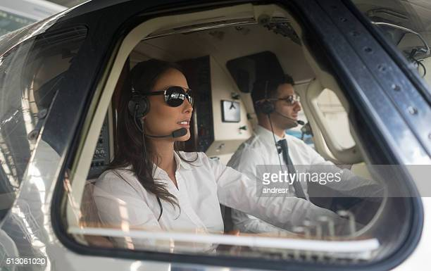 Male pilot and woman copilot traveling by helicopter