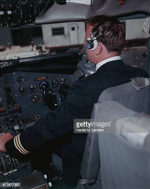 Male Pilot In Private Airplane Cockpit