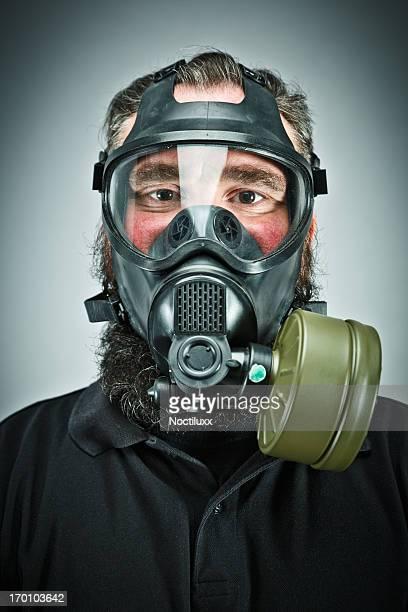 Male prepper wearing gas mask