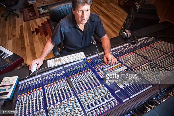 Male Recording Engineer and Artist in Studio