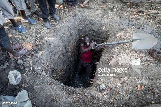 A male refugee seen digging a hole to be used as toilet The number of South Sudanese refugees who crossed its border has reached one million This...