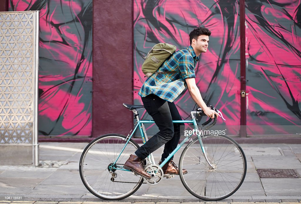 Male riding cycle, smiling : Stock Photo