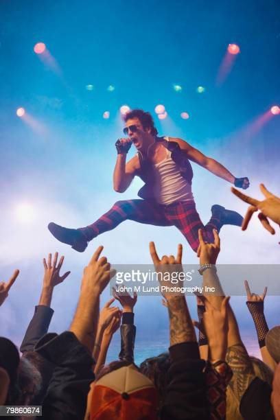 Male rock star performing in front of audience