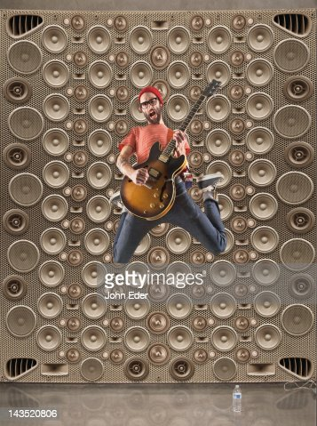 Male Rocker With Speakers : Stock Photo