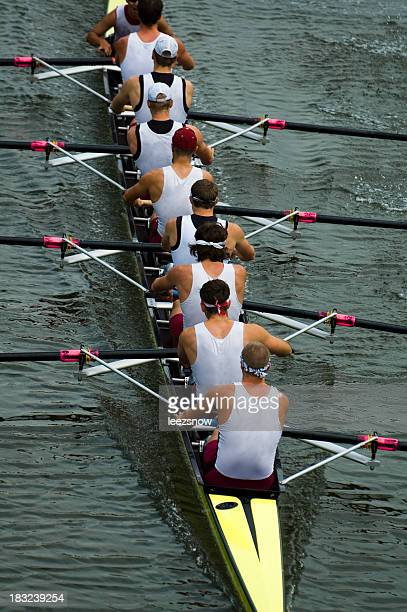 Male rowing team on ongoing competition