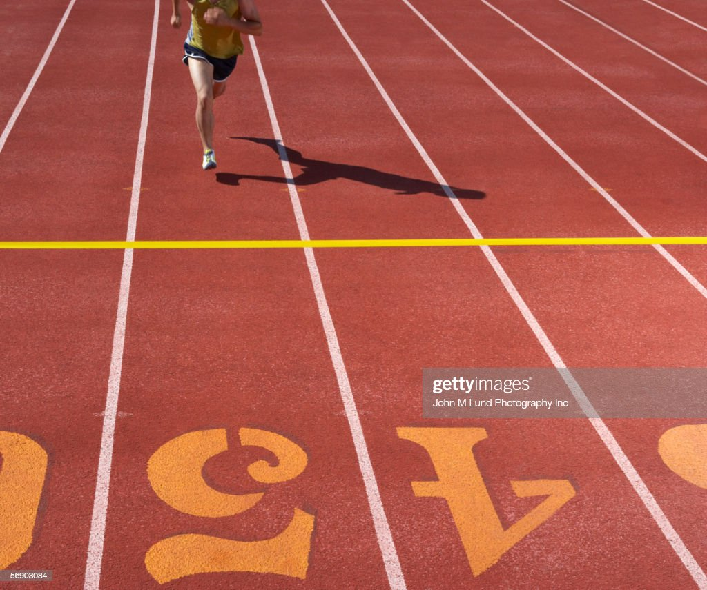 Male runner approaching finish line