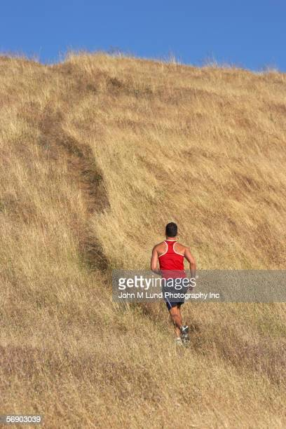 Male runner in golden field