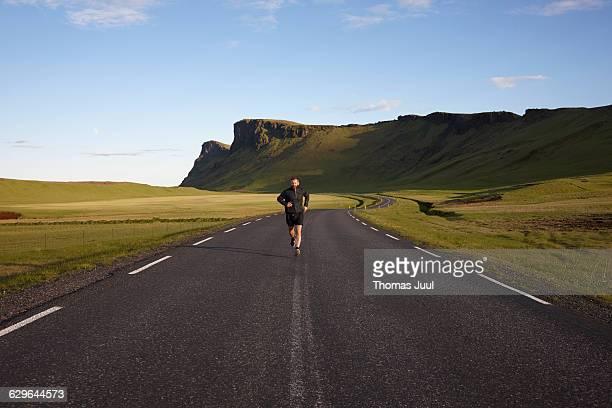 Male runner in sunset