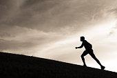Silhouette of male runner.