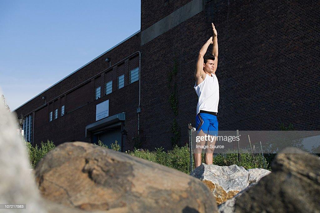 Male runner stretching : Stock Photo