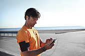 Male runner tjecking results on his smartphone