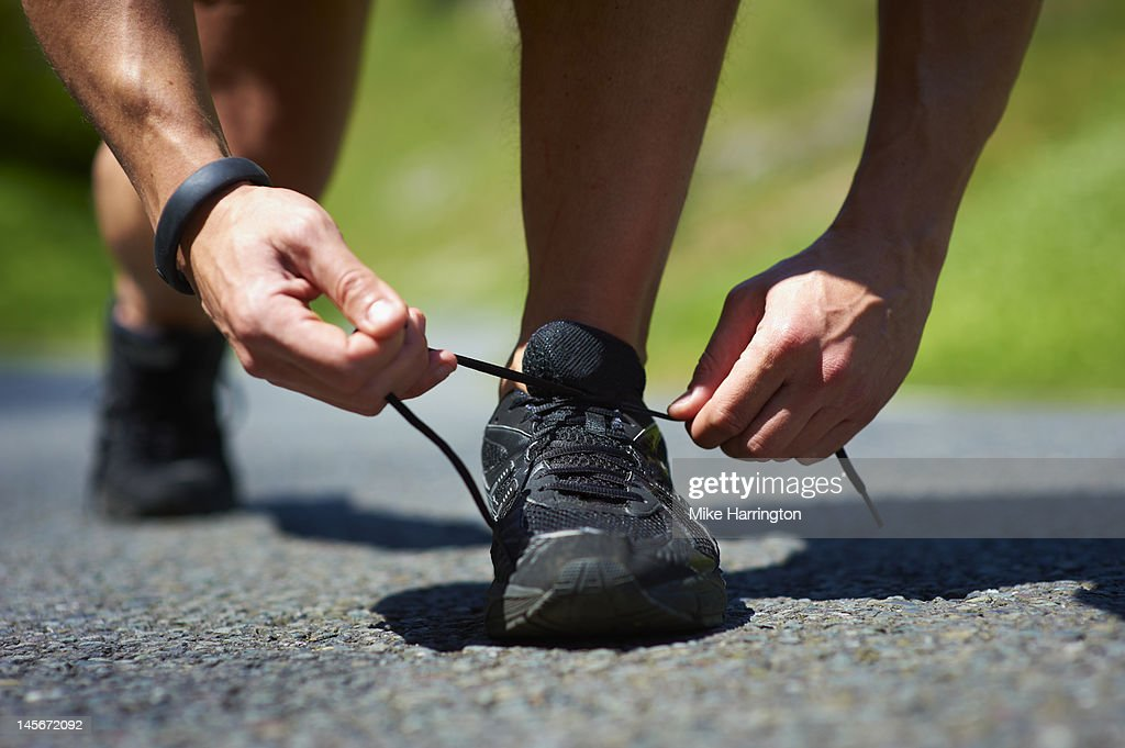 Male Runner Tying Shoe Lace : Stock Photo