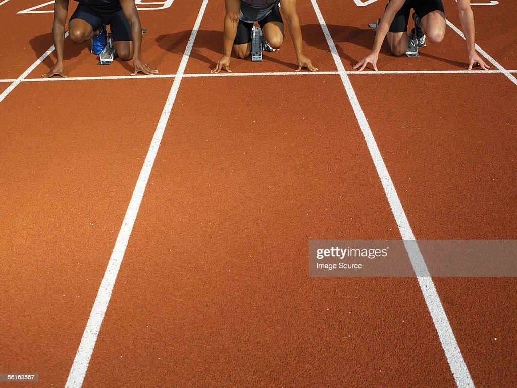 Male runners at starting line : Stock Photo