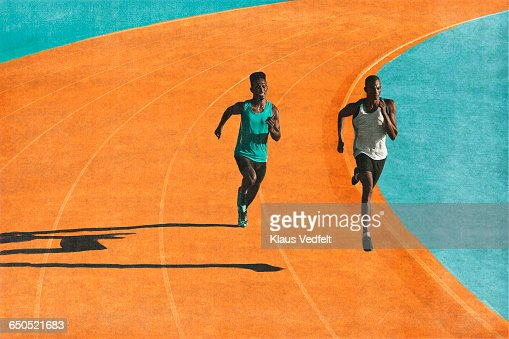 Male runners sprinting on track