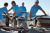 Male sailing team on yacht