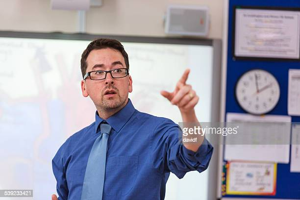 Male School Teacher Lecturing to Class