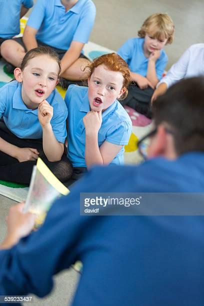 Male School Teacher Reading to Class
