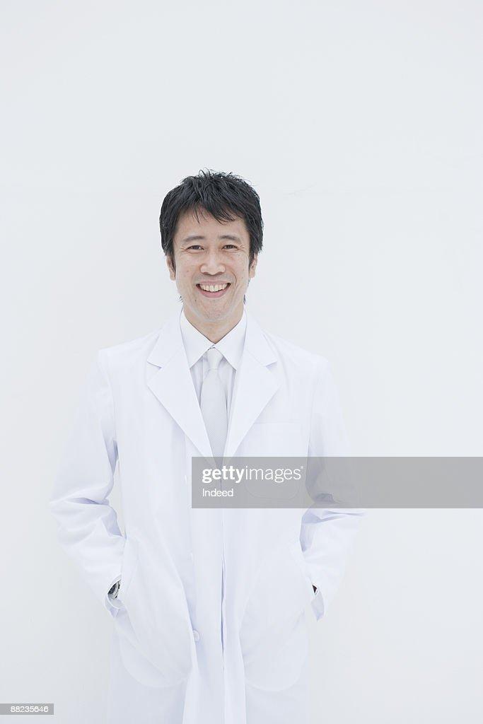 Male scientist smiling, portrait