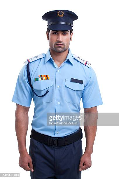 Male security guard standing over white background