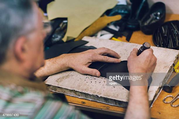 Male Shoemaker working.