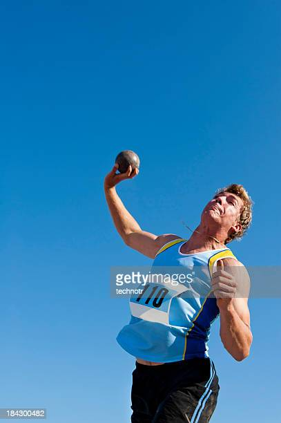 Male shot putter in the action