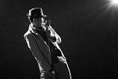 male singer in dark