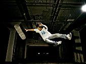 Male skateboarder in midair
