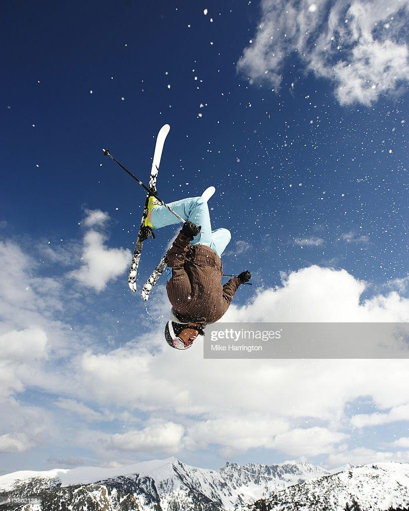 Male Skier Doing Backflip Off Bansko Cornice : Stock Photo