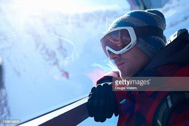 Male skier in mountain cable car.