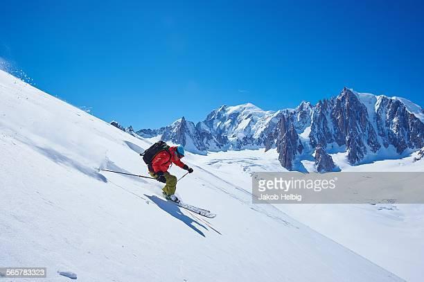 Male skier speeding downhill, Mont Blanc massif, Graian Alps, France