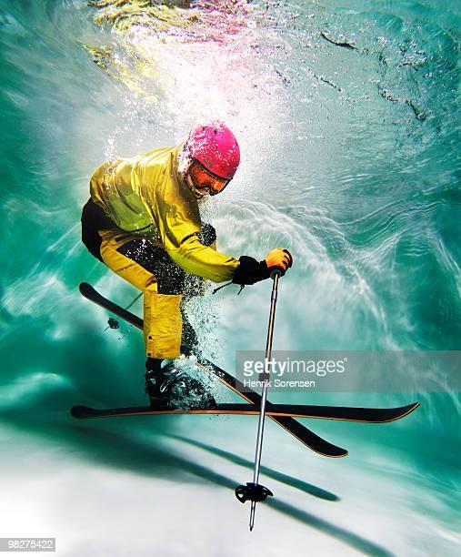 Male skier underwater
