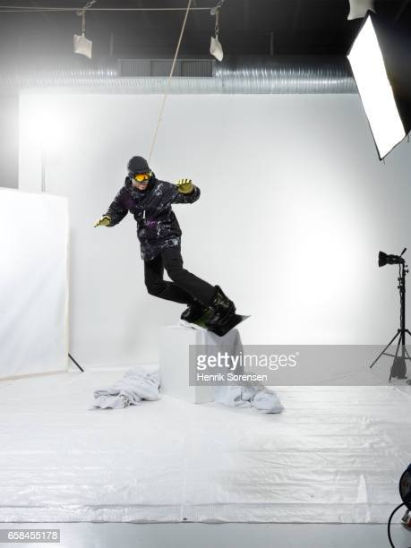 Male snowboarder in a studio