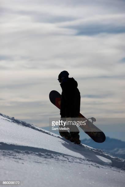 A male snowboarder in La Plagne ski resort in the French Tarentaise Valley