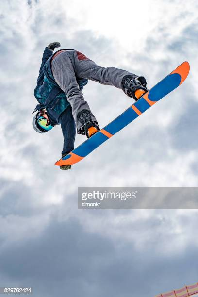 Male snowboarder in mid air