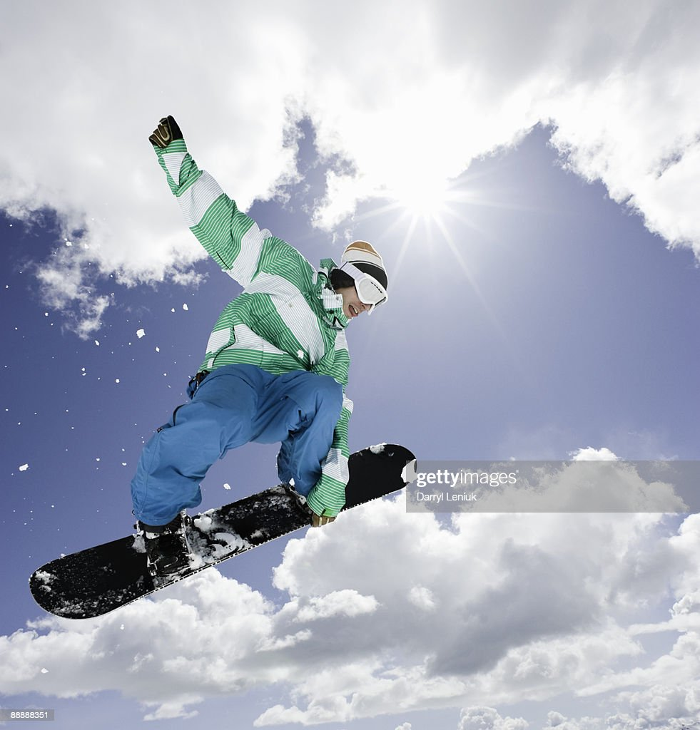 male snowboarder jumping in air : Stock Photo