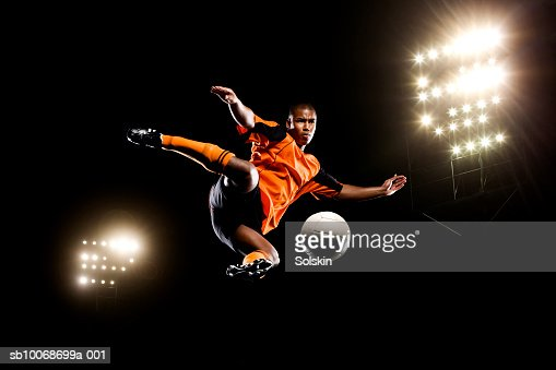Male soccer ball player kicking ball : Stock Photo