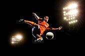 Male soccer ball player kicking ball